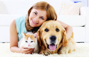 Woman with cat and dog